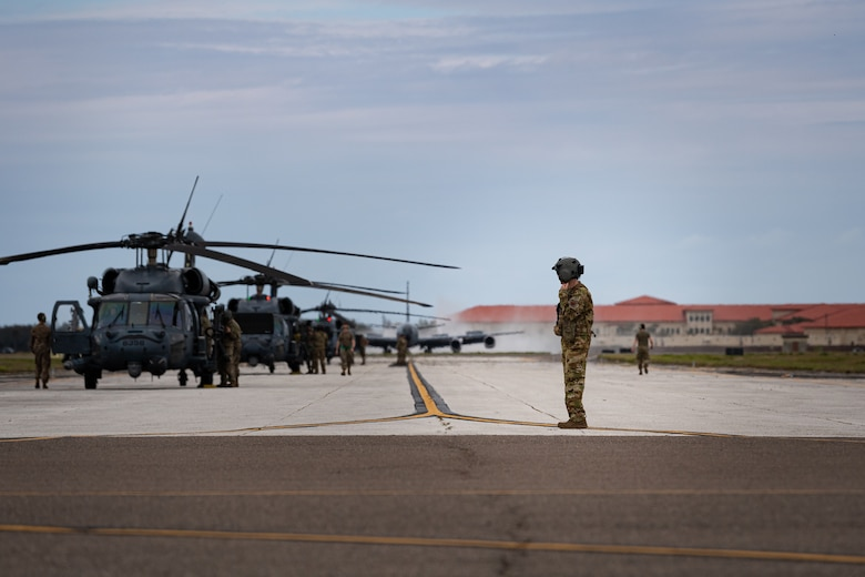 A photo of Airmen departing aircraft onto the flightline