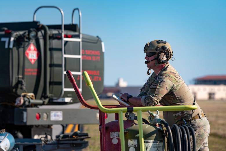 A photo of an Airman observing an exercise
