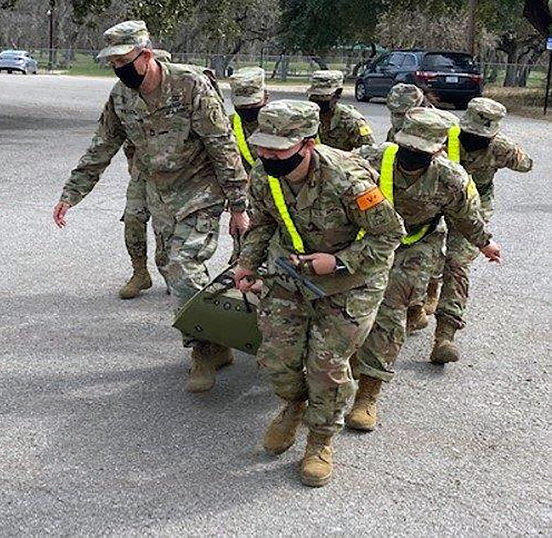 Advanced Individual Training Soldiers assigned to the U.S. Army Medical Center of Excellence demonstrate use of the sked and litter carries during patient evacuation during Soldier in Transition Training, or SiTT, at Joint Base San Antonio-Fort Sam Houston last month.