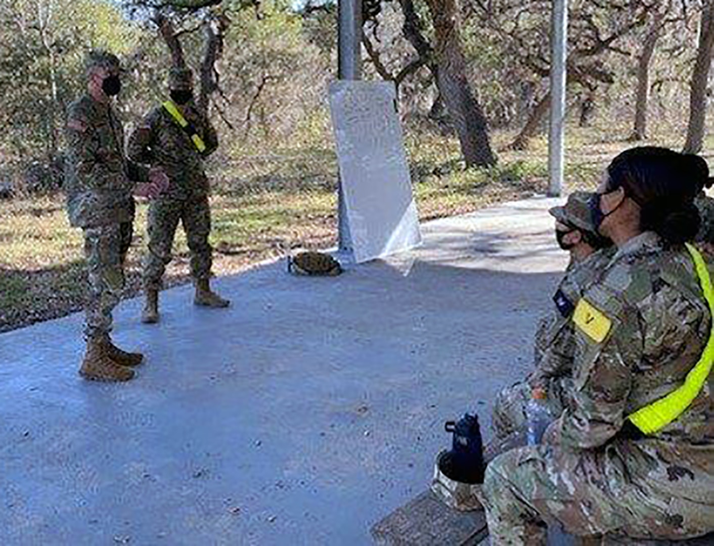 Pvt. Drew Smoker receives a command coin for excellence from U.S. Army Medical Center of Excellence Command Sgt. Maj. Clark Charpentier while assigned to the MEDCoE during Soldier in Transition Training, or SiTT, last month at Joint Base San Antonio-Fort Sam Houston.