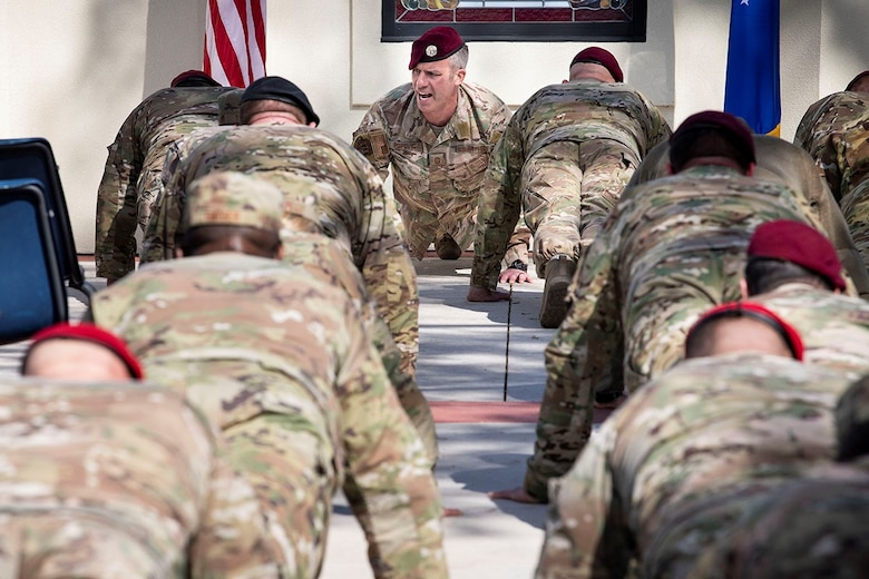 U.S. Air Force Chief Master Sgt. Todd Popovic, Special Warfare Training Wing command chief, leads participants in memorial pushups during the Master Sgt. John Chapman Medal of Honor plaque unveiling ceremony at Airmen's Heritage Park at Joint Base San Antonio-Randolph March 4, 2021.