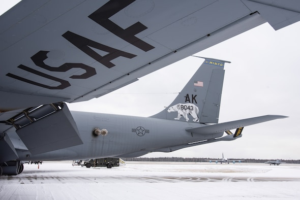 """A KC-135 Stratotanker from the Alaska Air National Guard's 168th Wing was unveiled showcasing a new tail flash on the wing's aircraft, Oct. 15, 2020. A polar bear stands strong on the wing's tail flash representing the arctic region and spirit of Alaska. The geometric design of the polar bear highlights the wing's culture of innovation. The 168th Wing continues to have strong ties to local communities in interior Alaska as the """"hometown Air Force."""" In collaboration with Tanana Chiefs Conference, the 168th Wing honors interior communities on the wing's aircraft. The first KC-135 revealed honors Minto and is one of nine total aircraft representing Alaska interior communities. The next aircraft to be unveiled will honor Gwichyaa Zhee, Grayling, Huslia, Tetlin, Telida, and Tanana. Additionally, Fairbanks and North Pole will be displayed on the final two aircraft. (U.S. Air National Guard photo by Senior Master Sgt. Julie Avey)"""