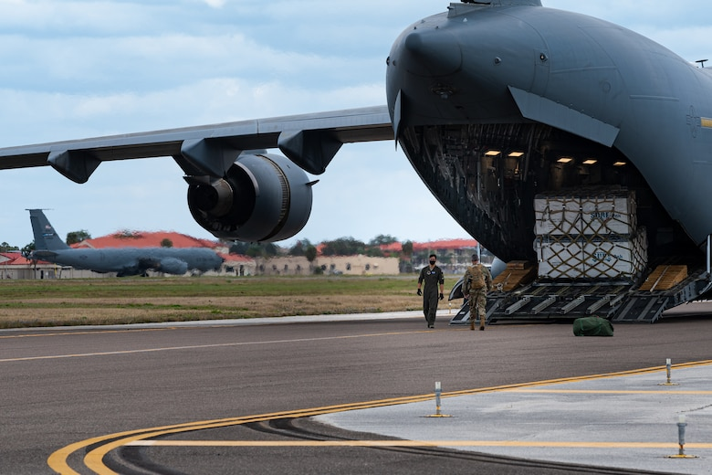 A photo of Airmen preparing to unload an aircraft