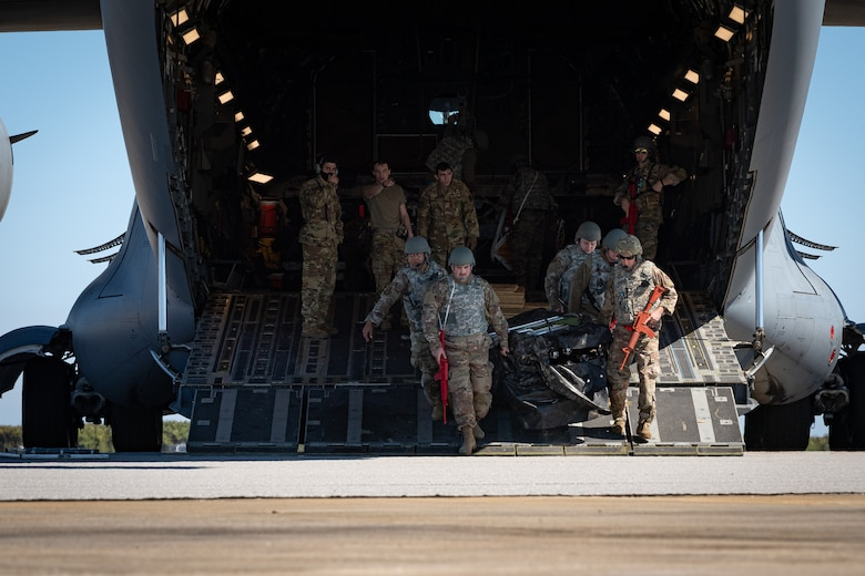 A photo of Airmen offloading cargo from an aircraft