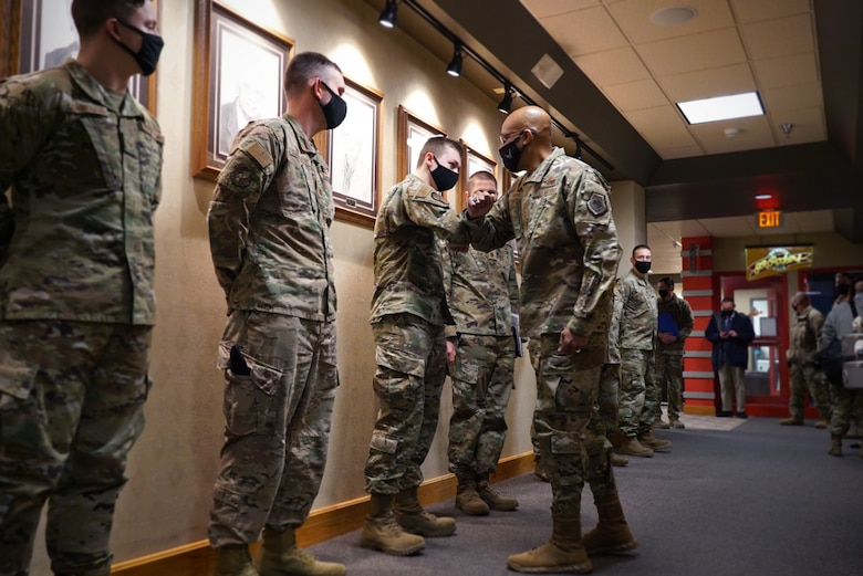Air Force Chief of Staff Gen. Charles Q. Brown, Jr. meets with outstanding Airmen of the 319th Reconnaissance Wing at Grand Forks Air Force Base, N.D., Feb. 17, 2021. The Airmen were nominated by their leadership, leading by example and for exceptional work in their duties across the base. (U.S. Air Force photo by Staff Sgt. Elora J. McCutcheon)