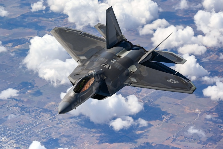 An F-22 Raptor Demonstration Team pilot flies behind a KC-135 Stratotanker from the 465th Air Refueling Squadron assigned to Tinker Air Force Base, Oklahoma, March 8. 2021. The F-22 team from Joint Base Langley–Eustis, Virginia, is assigne¬d to Air Combat Command and received fuel from the Okies during their flight back to their home station after performing at an air show. (U.S. Air Force photo by Senior Airman Mary Begy)