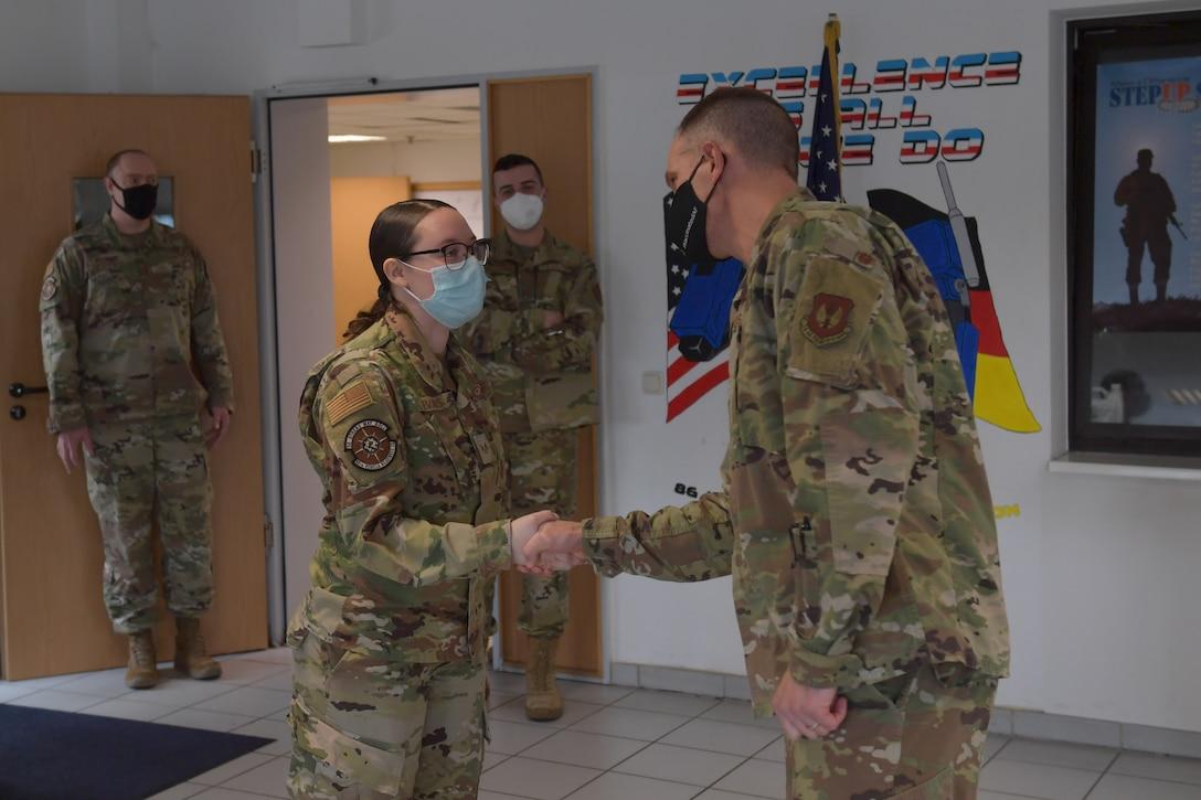 Airmen standing in a room.