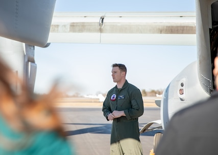 U.S. Marine Corps Capt. Nathan A. Sampson, a pilot with Marine Medium Tiltrotor Squadron (VMM) 365, 2nd Marine Aircraft Wing, speaks to students at the Freedom Aviation Airport in Lynchburg, Virginia, March 3, 2021. Marines with VMM-365 brought the MV-22B Osprey to display for Liberty University's career fair; Marines interacted with the students and answered their questions about aviation and pilot opportunities in the Marine Corps. (U.S. Marine Corps photo by Cpl. Cody J. Ohira)