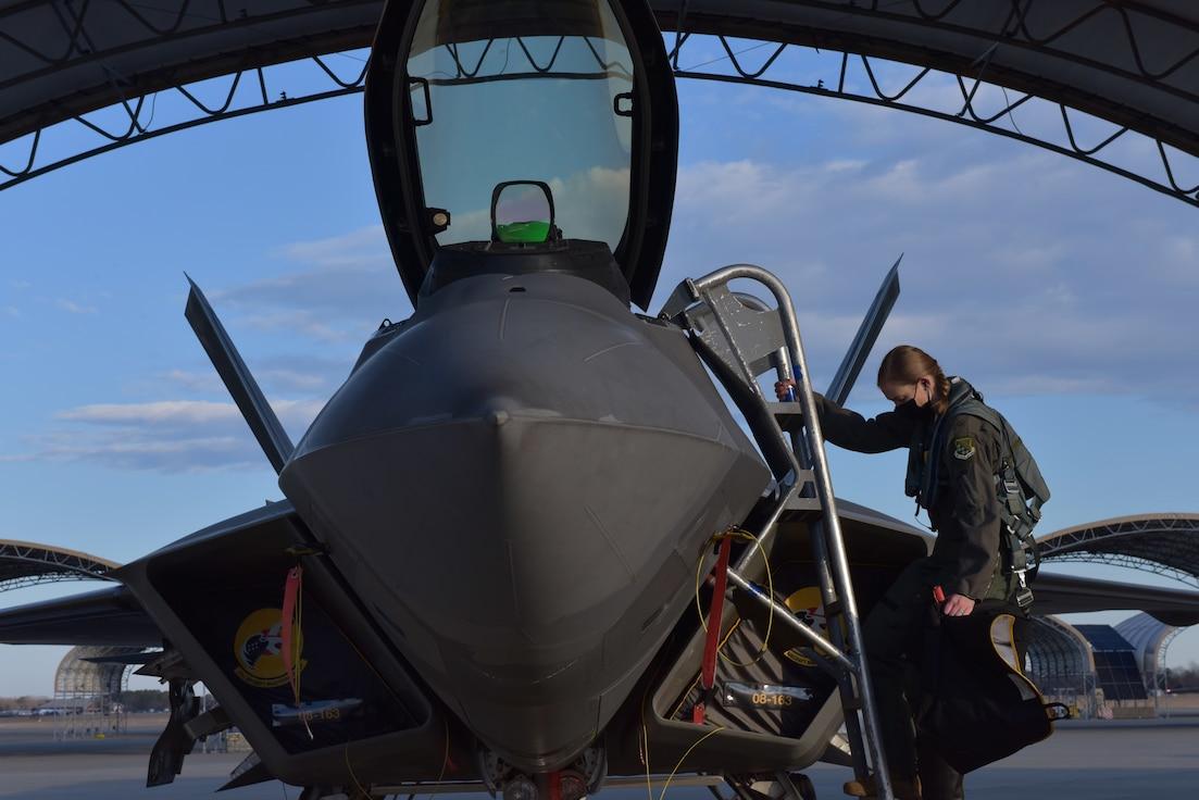 Pilot climbs into F-22 Raptor