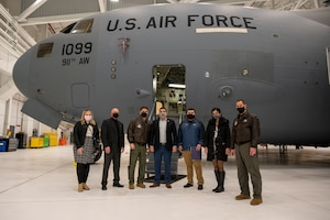 911th Airlift Wing leadership, Pennsylvania State Sen. Devlin Robinson and his staff take advantage of a photo opportunity in front of a C-17 Globemaster III inside the new two-bay hangar at the Pittsburgh International Airport Air Reserve Station, Pennsylvania, Feb. 26, 2021.