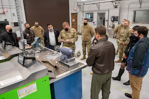 Staff Sgt. Adam Kitta, 911th Maintenance Squadron metals technician, explains the process and benefits of metal fabrication to Pennsylvania State Sen. Devlin Robinson at the Pittsburgh International Airport Air Reserve Station, Pennsylvania, Feb. 26, 2021.