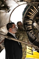 Maj. Joe Walters, 911th Aircraft Maintenance Squadron commander, explains the process of changing an engine on a C-17 Globemaster III to Pennsylvania State Sen. Devlin Robinson at the Pittsburgh International Airport Air Reserve Station, Pennsylvania, Feb. 26, 2021.