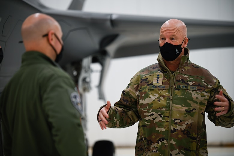 """U.S. Air Force Col. David Berkland, the 354th Fighter Wing commander, talks to U.S. Space Force Gen. John W. """"Jay"""" Raymond, Chief of Space Operations, on Eielson Air Force Base, Alaska, March 10, 2021."""