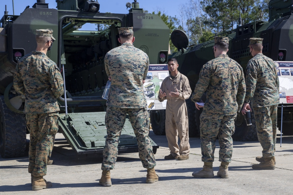 U.S. Marines with 2d Marine Division engage in a static display of an Amphibious Combat Vehicle (ACV) on Camp Lejeune, N.C., March 8, 2021. During the display, Marines gained knowledge and familiarity with the new vehicle. The ACV is replacing the Assault Amphibious Vehicle currently used around the Marine Corps and it will provide a more modern and advanced amphibious assault platform that will increase the Marine Corps' maritime capabilities as a naval expeditionary force. (U.S. Marine Corps photo by Pfc. Sarah Pysher)