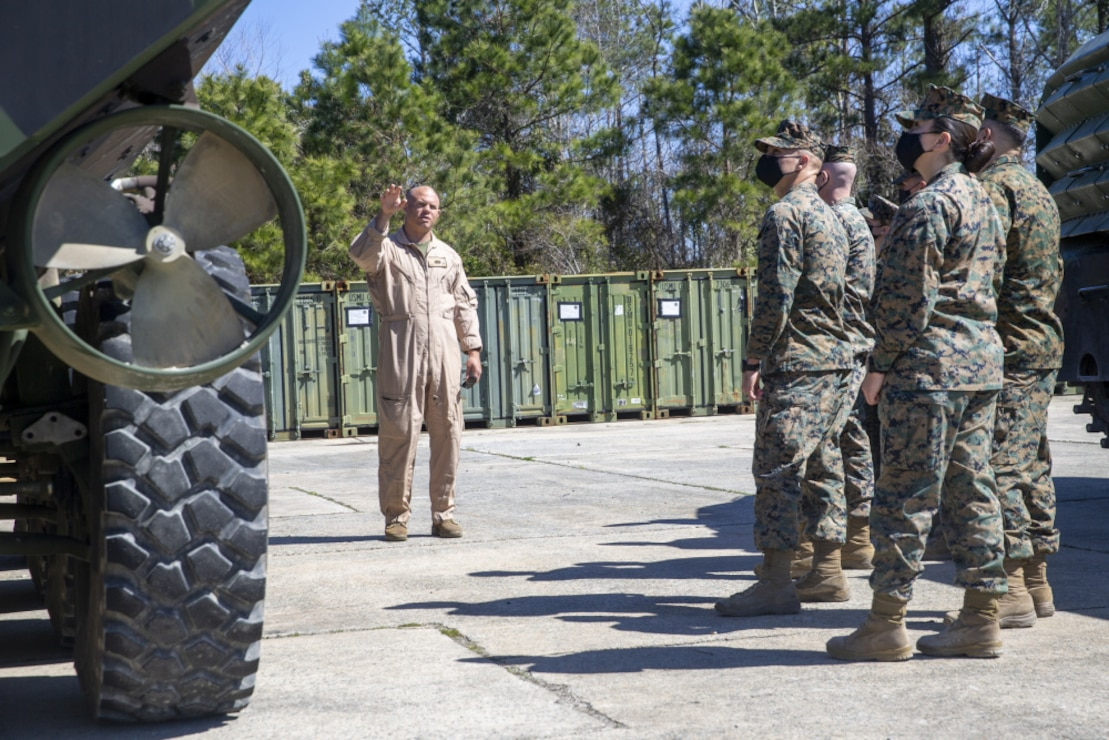 U.S. Marines with 2d Marine Division observe an Amphibious Combat Vehicle (ACV) during a static display on Camp Lejeune, N.C., March 8, 2021. During the display, Marines gained knowledge and familiarity with the new vehicle. The ACV is replacing the Assault Amphibious Vehicle currently used around the Marine Corps and it will provide a more modern and advanced amphibious assault platform that will increase the Marine Corps' maritime capabilities as a naval expeditionary force. (U.S. Marine Corps photo by Pfc. Sarah Pysher)