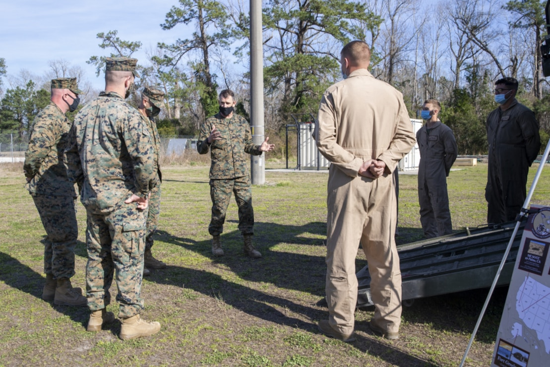 U.S. Marine Corps Maj. Gen. Francis Donovan, the Commanding General of 2d Marine Division, speaks with Marines about an Amphibious Combat Vehicle (ACV) during a static display on Camp Lejeune, N.C., March 9, 2021. During the display, Marines gained knowledge and familiarity with the new vehicle. The ACV is replacing the Assault Amphibious Vehicle currently used around the Marine Corps and it will provide a more modern and advanced amphibious assault platform that will increase the Marine Corps' maritime capabilities as a naval expeditionary force. (U.S. Marine Corps photo by Pfc. Sarah Pysher)
