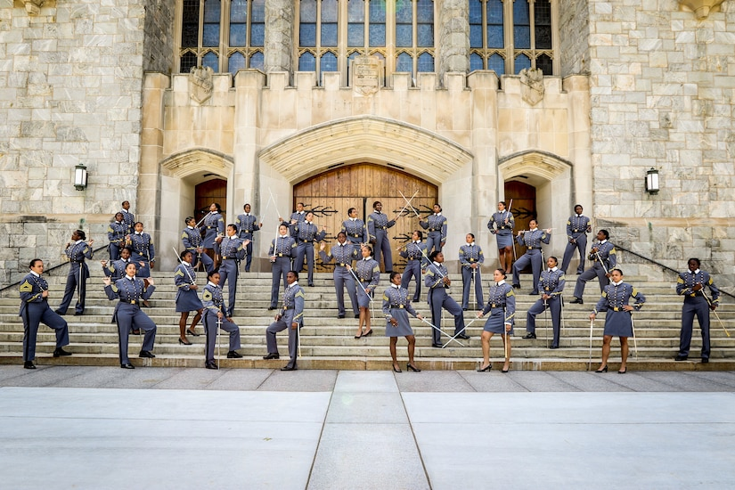 Women cadets stand on the steps of a building at West Point, N.Y.