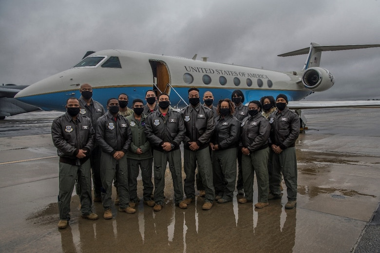The 89th Airlift Wing's First African American Heritage Flight pose for a photo on the flightline at Joint Base Andrews, Md., Sunday, Feb. 19-21, 2021.