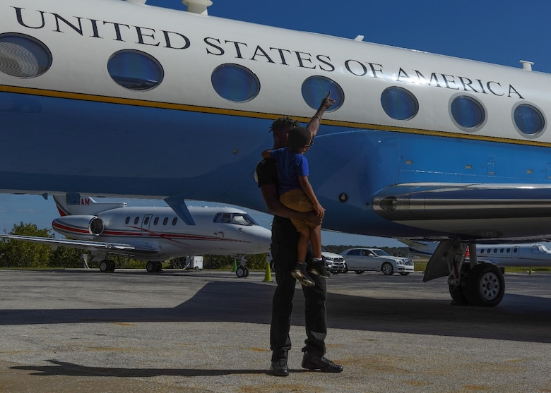 Jauhar El-Amin and his son, Saint El-Amin, age 8, checkout a C-37B Gulfstream aircraft during 89th Airlift Wing African American Heritage Flight's stop at Clearwater, Fla., Sunday, Feb. 21, 2021.