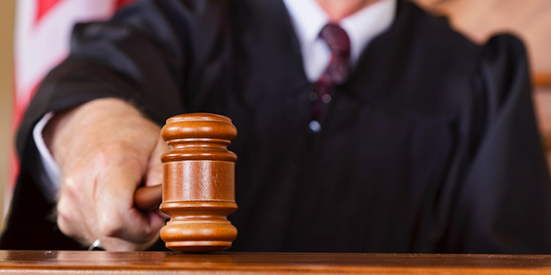 A close-up of a judge's gavel in his hand © iStock.com/RichLegg