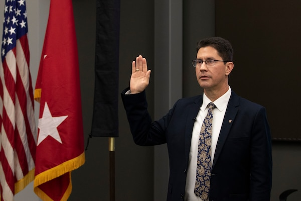 Dr. Edmond Russo, director of the U.S. Army Engineer Research and Development Center's (ERDC) Environmental Laboratory (EL), takes the oath as he is inducted into the Senior Executive Service (SES) during a hybrid virtual and in-person SES induction ceremony held at the ERDC-EL building in Vicksburg, Miss., March 11, 2021.