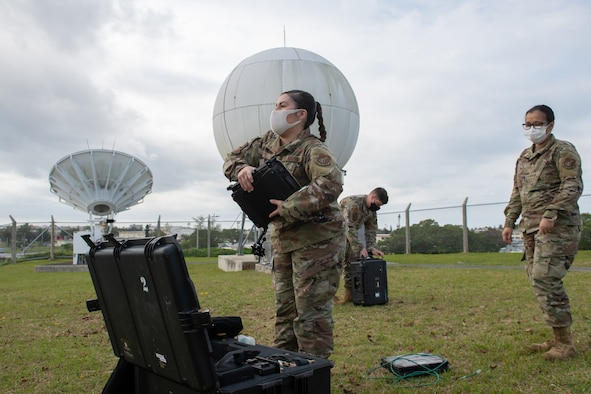 18th CS assembles a VSAT satellite.