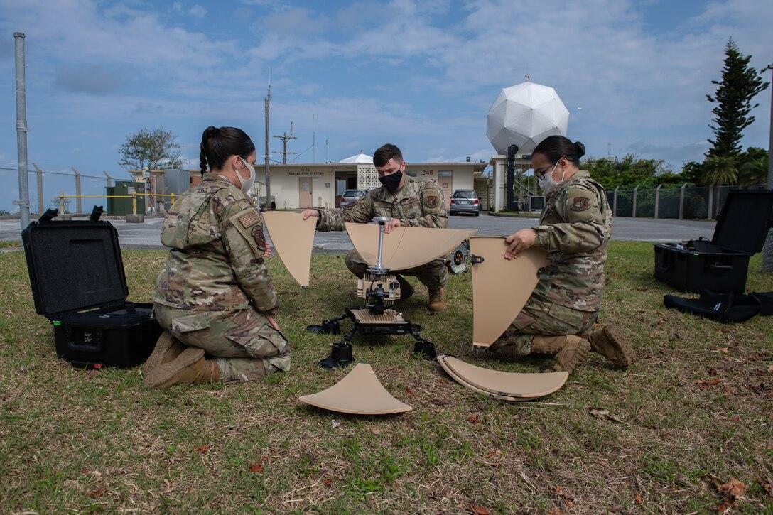 18th CS assembles a VSAT satellite.