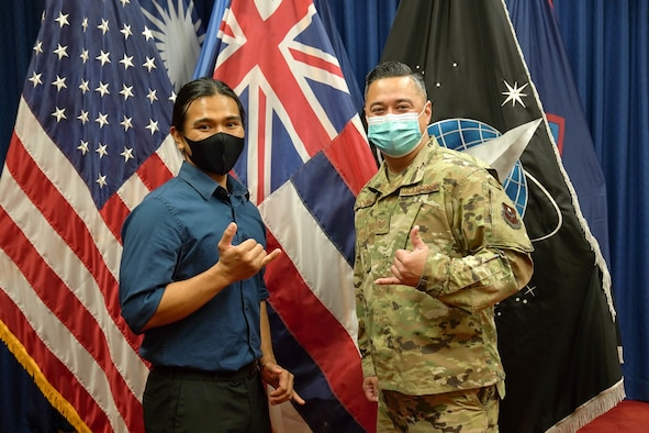 Reyjie Cliff Blando Madriaga, U.S. Space Force recruit, and his recruiter, U.S. Air Force Tech. Sgt. Shiloh Pogue, Pacific Operations Recruiter, after completing the oath of enlistment at Joint Base Pearl Harbor-Hickam, Hawaii, March 4, 2021. Madriaga, born and raised in Hawaii, is the first Hawaiian U.S. Space Force Recruit to swear into the Delayed Entry Program at Honolulu Military Entrance Processing Center.  (U.S. Air Force photo by Airman 1st Class Makensie Cooper)