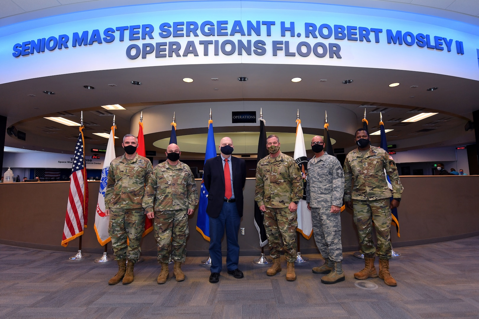 Military leaders gather to discuss protect and defend mission.
