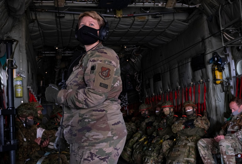 Staff Sgt. Lauren Shaw, 36th Airlift Squadron loadmaster, prepares for a static-line jump during exercise Airborne 21 near Camp Fuji, Japan, March 9, 2021