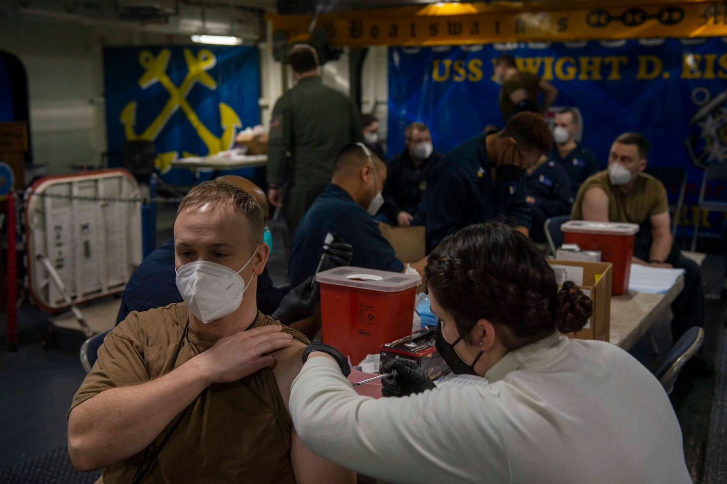 210311-N-MW930-1013 MEDITERRANEAN SEA (March 11, 2021) Sailors receive a second dose of the COVID-19 vaccination aboard the Nimitz-class aircraft carrier USS Dwight D. Eisenhower (CVN 69), in the Mediterranean Sea, March 11, 2021. The IKE Carrier Strike Group is on a scheduled deployment in the U.S. Sixth Fleet area of operations in support of U.S. national interests and security in Europe and Africa.