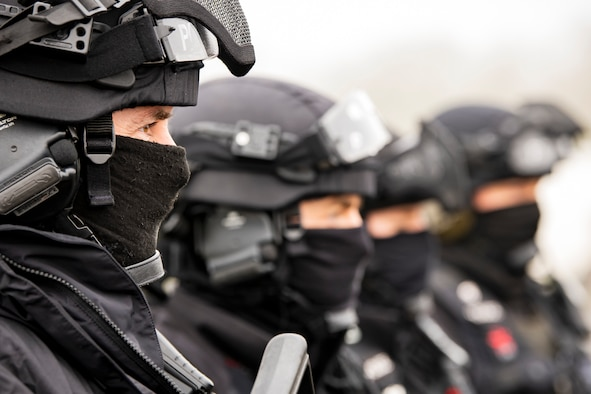 Policemen, from the Northamptonshire Police Department, stand in formation prior to a field training exercise at RAF Croughton, England, Mar. 3, 2021. The NHPD utilized the 422d Security Forces Squadron training complex to help strengthen their tactics and techniques. Events like this help strengthen the local partnership between the 422d SFS and the NHPD. (U.S. Air Force photo by Senior Airman Eugene Oliver)