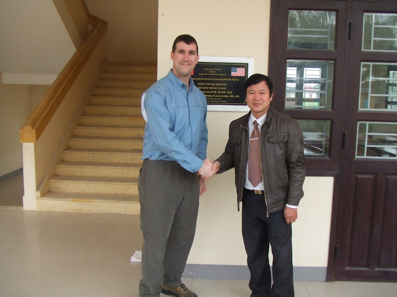 Then Capt. Daniel J. Fox with the U.S. Army Corps of Engineers, Alaska District, poses with the principal at Kien Quoc Primary School in Vietnam after a one-year warranty inspection in 2011, a year after the school was completed in July 2010. Recently promoted to lieutenant colonel, Fox now serves as the Deputy District Commander of the U.S. Army Corps of Engineers, Europe District which similarly supports humanitarian assistance projects in Europe and in Africa. (Courtesy Photo)