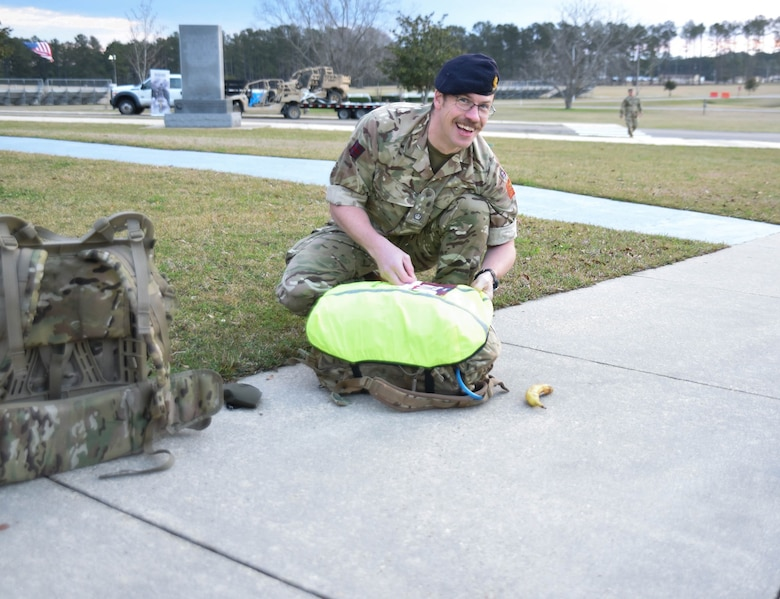 British Liaison to the U.S. Army Engineer Research and Development Center Maj. Peter Mackintosh prepares for the18.6-mile Norwegian Foot March at Camp Shelby Joint Forces Training Center, near Hattiesburg, Miss., March 6, 2021. Mackintosh and five additional ERDC Soldiers, including ERDC Commander Col. Teresa Schlosser, Lt. Col. Christian Patterson, Maj. Earl Dean, Capt. Patrick Border and Capt. Jeremiah Paterson, completed the event. (Photo by 2nd Lt. Michael Needham, U.S. Army National Guard)