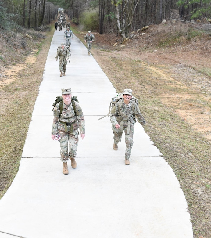 U.S. Army Engineer Research and Development Center Commander Col. Teresa Schlosser walks with a troop during the 18.6-mile Norwegian Foot March at Camp Shelby Joint Forces Training Center, near Hattiesburg, Miss., March 6, 2021. Schlosser and five additional ERDC Soldiers, including Lt. Col. Christian Patterson, Maj. Earl Dean, British Liaison Maj. Peter Mackintosh, Capt. Patrick Border and Capt. Jeremiah Paterson, completed the event. (Photo by 2nd Lt. Michael Needham, U.S. Army National Guard)