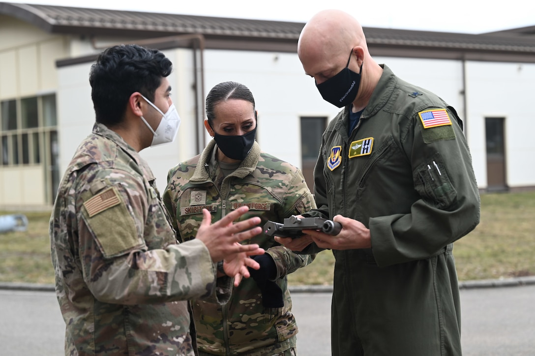 U.S. Air Force Staff Sgt. Emilio Solis, 786th Civil Engineer Squadron explosive ordnance disposal quality assurance noncommissioned officer in charge, shows U.S. Air Force Brig. Gen. Josh Olson, 86th Airlift Wing commander, and 86th AW Command Chief Master Sgt. Hope Skibitsky a MK-1 socket wrench during a EOD demonstration