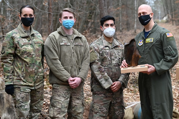 U.S. Air Force Brig. Gen. Josh Olson, 86th Airlift Wing commander, and 86th AW Command Chief Master Sgt. Hope Skibitsky pose for a photo with Airmen assigned to the 786th Civil Engineer Squadron's Explosive Ordnance Disposal Flight during a EOD demonstration