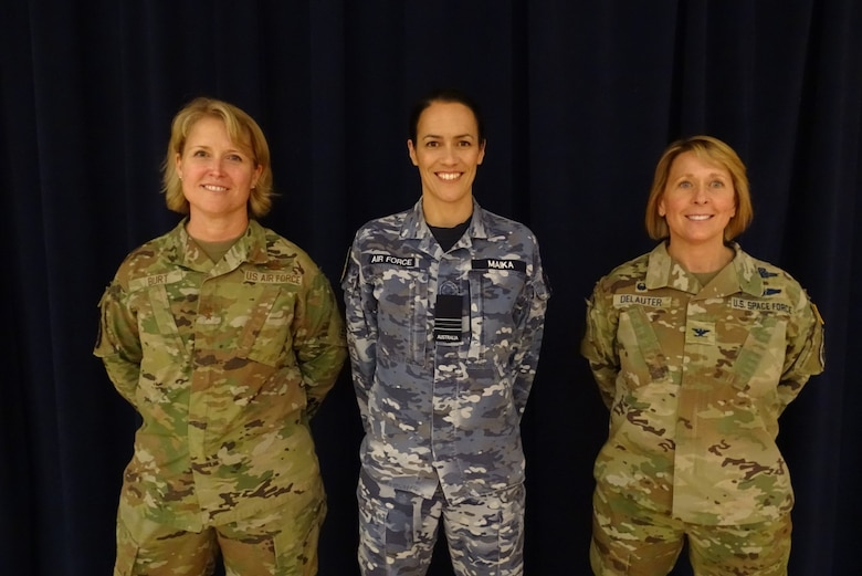 Group photo with Royal Australian Air Force Squadron Leader Jaimee Maika, chief of strategy at the Combined Space Operations Center, stands with Combined Force Space Component Command commander Maj. Gen. DeAnna Burt, and Space Delta 5 commander and CSpOC director Col. Monique DeLauter