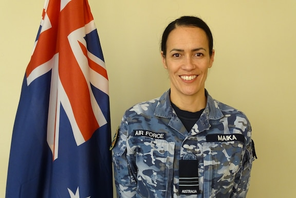 Photo of Royal Australia Air Force Squadron Leader Jaimee Maika with Australian Flag
