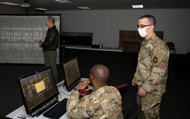 Col Robert N Osborn, Vice Commander, 916th Air Refueling Wing positions himself for the scenario SSgt Jeremy Brown, 916SFS member selected during a command immersion brief about the MILO trainer on Feb 5. 2021.