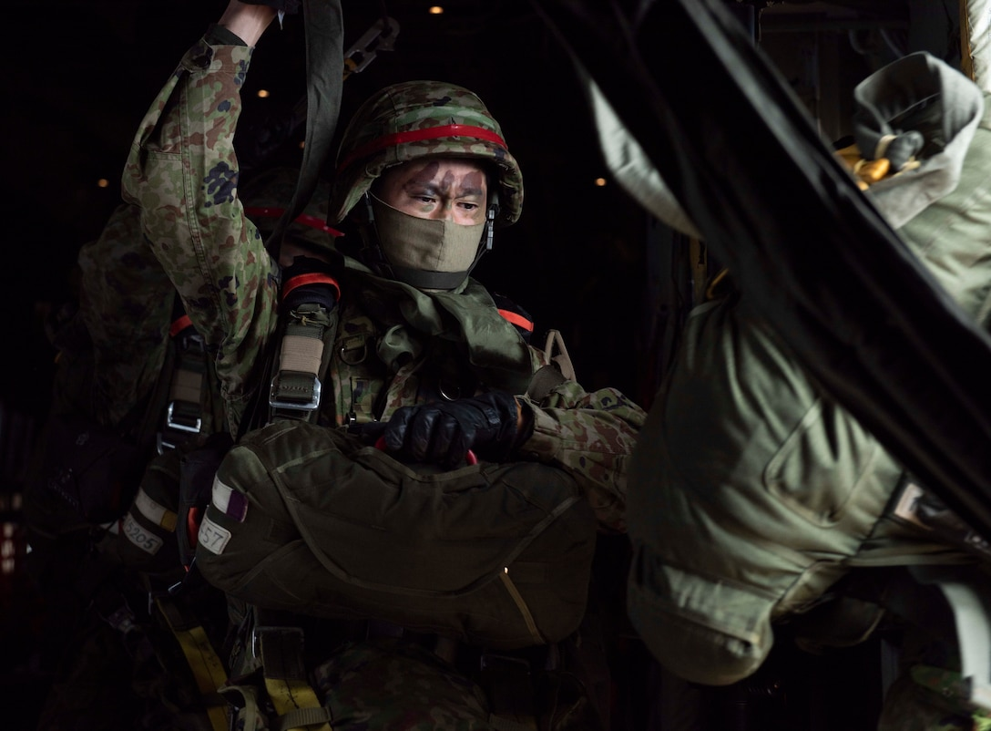 A Japan Ground Self Defense Forces paratrooper jumps out of a C-130J Super Hercules C-130J Super Hercules assigned to the 36th Airlift Squadron during an Airborne 21 exercise