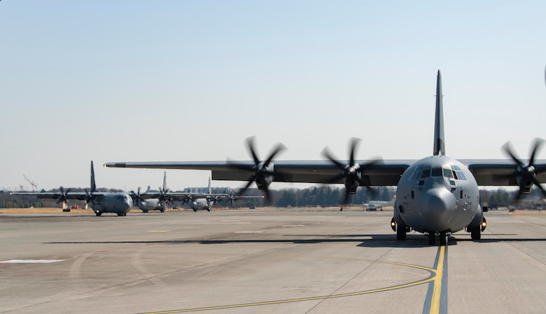 C-130J Super Hercules taxi across the flightline following an equipment airdrop as part of exercise Airborne 21, at Yokota Air Base, Japan, March 11, 2021