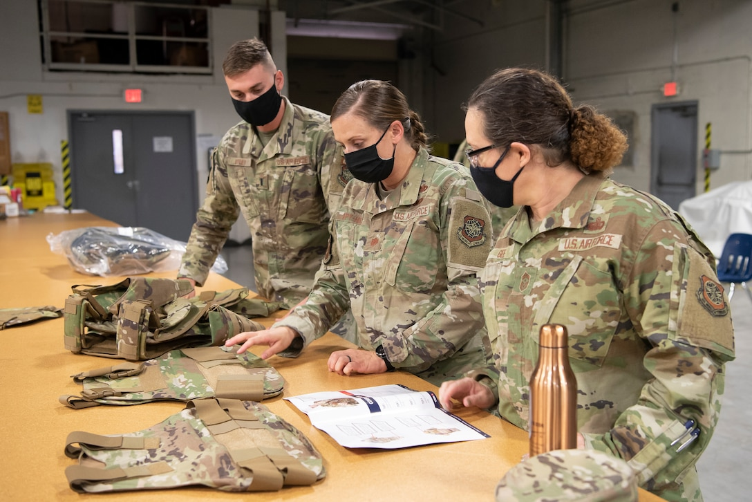 6th Air Refueling Wing command chief, Chief Master Sgt. Shae Gee (right), learns about the new female Improved Outer Tactical Vest at MacDill Air Force Base, Fla., Feb. 17, 2021.