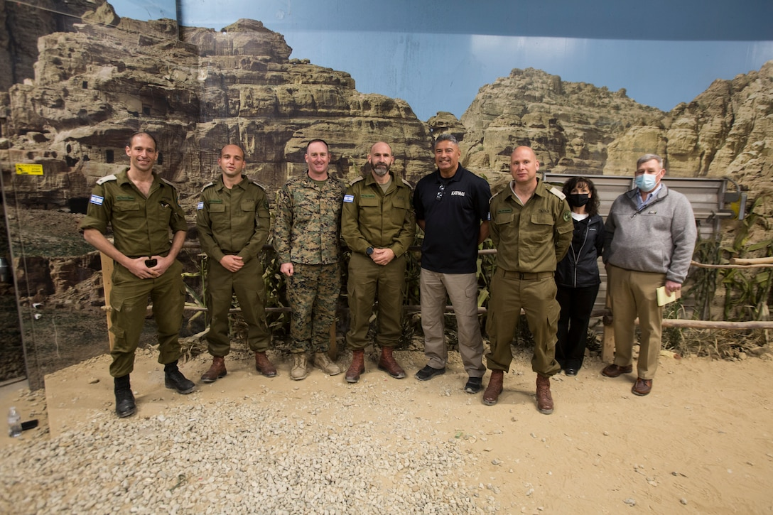 Israeli Defense Forces leaders pose for a group photo with staff from the Simulator Integration Center and Range Control Operations Complex and Infantry Immersion Trainer during a tour from II Marine Expeditionary Force personnel which showcased various simulation and training facilities on Camp Lejeune, N.C., Mar. 10, 2021. The purpose of the visit was for IDF leaders to develop relationships with II MEF personnel and learn about Marine Corps training, simulators, and how they are integrated into training and exercises to create fighters and leaders for the battlefield. (U.S. Marine Corps photo by Sgt. Jesus Sepulveda Torres)