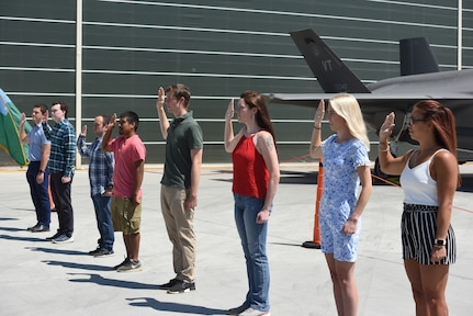New Airmen take their oaths of enlistment in a ceremony at Vermont Air National Guard Base Aug. 14, 2020. The Vermont Commission on Women spoke with Adjutant General Maj. Gen. Greg Knight and women leaders in the Vermont National Guard March 10, 2021, about what the Vermont Guard is doing to recruit and retain women within its ranks. Women comprise about 20 percent of the Vermont Air National Guard and 15 percent of the Vermont Army National Guard. (U.S. Army National Guard photo by Capt. J. Scott Detweiler)