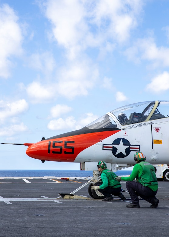 """210205-N-UF271-1034 ATLANTIC OCEAN (Feb. 5, 2021) Italian Navy Ensign Erika Raballo, a student naval aviator assigned to the """"Tigers"""" of Training Squadron 9, prepares to launch off USS Gerald R. Ford's (CVN 78) flight deck in a T-45C Goshawk jet trainer aircraft Feb. 5, 2021. Carrier qualification is one of the final elements of the undergraduate strike pilot training curriculum under Chief of Naval Air Training. Ford is underway in the Atlantic Ocean conducting carrier qualifications. (U.S. Navy photo by Mass Communication Specialist Seaman Anton Wendler)"""