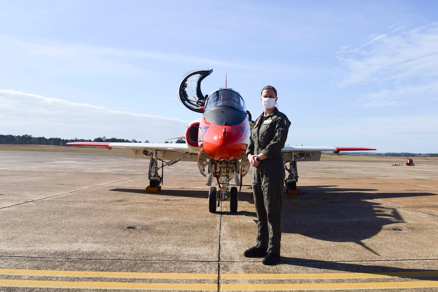 """Italian navy Ensign Erika Raballo stands in front of a T-45C Goshawk jet trainer aircraft after completing her last graded flight with the """"Tigers"""" of Training Squadron (VT) 9 qualifying her as a naval aviator at Naval Air Station Meridian, March 10."""