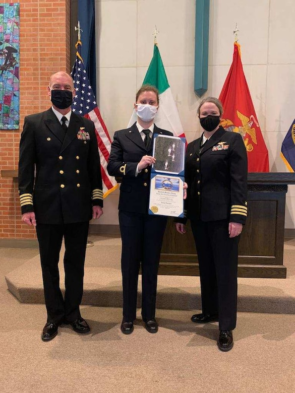 Italian navy Ensign Erika Raballo, center, stands with Commodore, Training Air Wing 1 Capt. Tracey Gendreau, left, and Training Squadron (VT) 9 Commanding Officer Cmdr. Meghan Angermann during her winging ceremony at Naval Air Station Meridian base chapel, March 11.