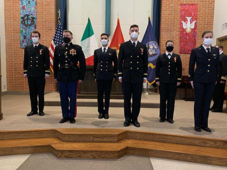 Italian navy Ensign Erika Raballo, right, stands with her classmates during a Training Air Wing (TW) 1 winging ceremony at Naval Air Station Meridian base chapel on March 11.