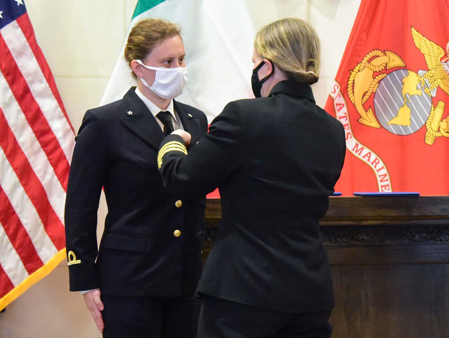 Training Squadron (VT) 9 Commanding Officer Cmdr. Meghan Angermann, right, pins naval aviator Wings of Gold on Italian navy Ensign Erika Raballo during a ceremony at Naval Air Station Meridian base chapel on March 11, 2021.